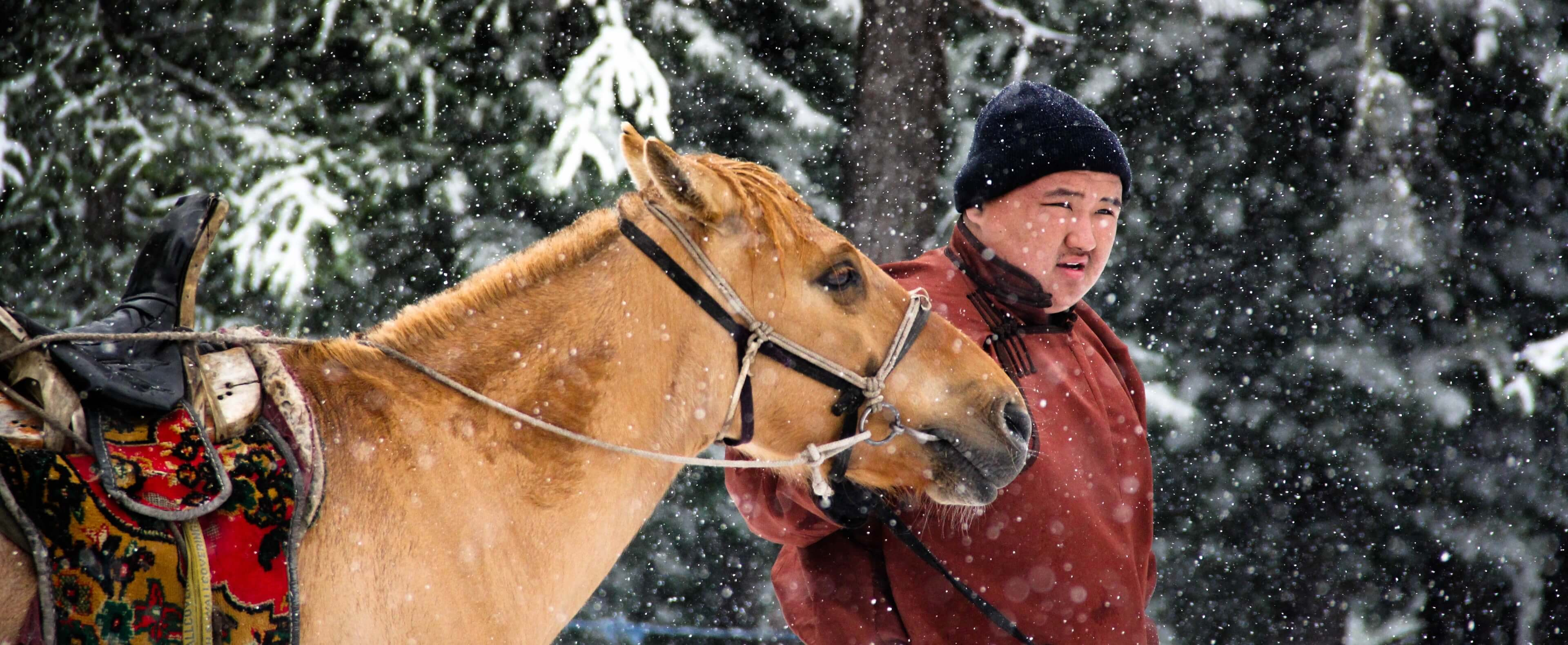 A Mongolian man with a horse