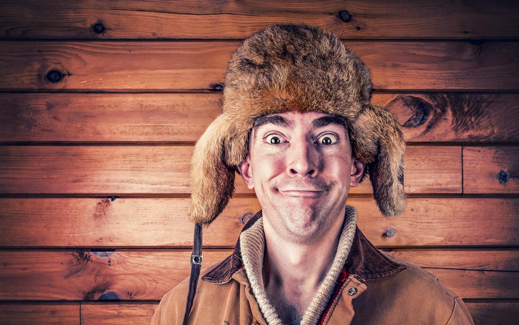 A man wearing a traditional Russian ushanka hat