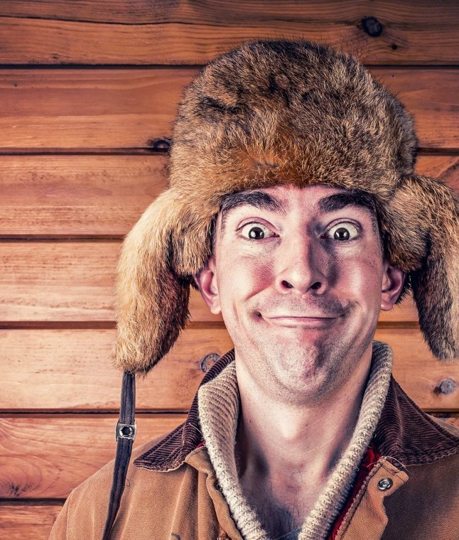 A man wearing a traditional Russian ushanka hat